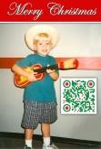 Tyler, age 4 playing ukulele.