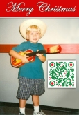 Tyler, age 4 playing ukulele.